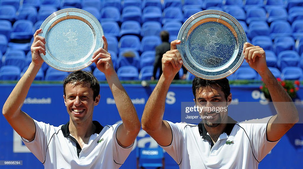 <a gi-track='captionPersonalityLinkClicked' href=/galleries/search?phrase=Daniel+Nestor&family=editorial&specificpeople=212827 ng-click='$event.stopPropagation()'>Daniel Nestor</a> (L) of Canada and <a gi-track='captionPersonalityLinkClicked' href=/galleries/search?phrase=Nenad+Zimonjic&family=editorial&specificpeople=243242 ng-click='$event.stopPropagation()'>Nenad Zimonjic</a> of Serbia hold up their winners trophy after the final doubles match against Lleyton Hewitt of Australia and Mark Knowles of the Bahamas on day seven of the ATP 500 World Tour Barcelona Open Banco Sabadell 2010 tennis tournament at the Real Club de Tenis on April 25, 2010 in Barcelona, Spain.