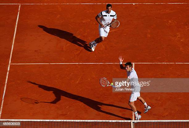 Daniel Nestor of Canada and Nenad Zimonjic of Serbia in action against Bob and Mike Bryan of USA in the doubles semi final during day seven of the...