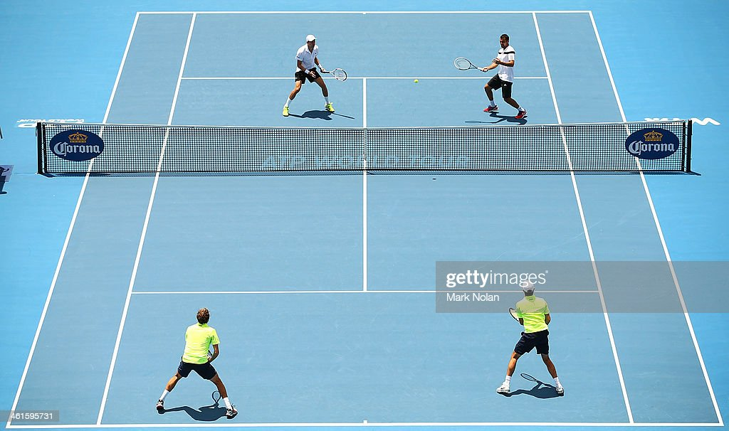 Daniel Nestor of Canada and Nenad Zimonjic of Serbia in action in their doubles match against Julien Benneteau and Edouard Roger-Vasselin of France during day five of the 2014 Sydney International at Sydney Olympic Park Tennis Centre on January 9, 2014 in Sydney, Australia.