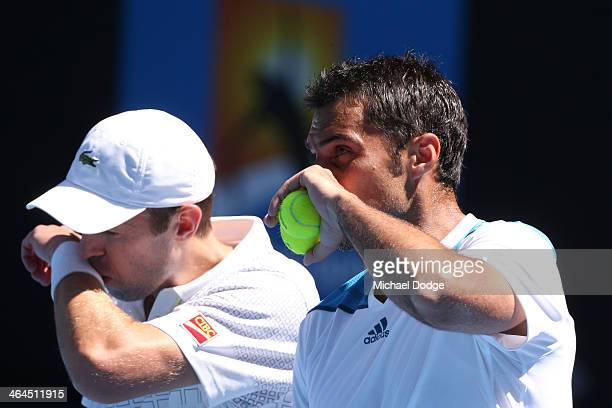 Daniel Nestor of Canada and Nenad Zimonjic of Serbia in action in their semifinal doubles match against Eric Butorac of the United States Raven...