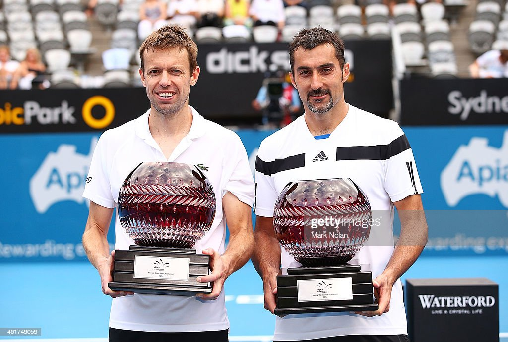 Daniel Nestor of Canada and Nenad Zimonjic of Serbia pose with trophies after winning the Mens Doubles Final against Rohan Bopanna of India and Aisam-Ul-Haq Qureshi of Pakistan during day seven of the Sydney International at Sydney Olympic Park Tennis Centre on January 11, 2014 in Sydney, Australia.