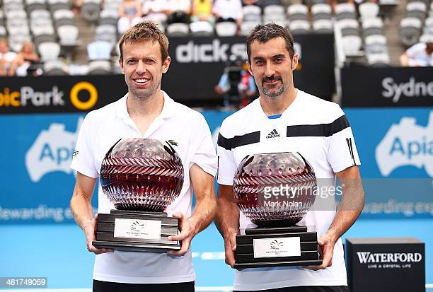 Daniel Nestor of Canada and Nenad Zimonjic of Serbia pose with trophies after winning the Mens Doubles Final against Rohan Bopanna of India and...