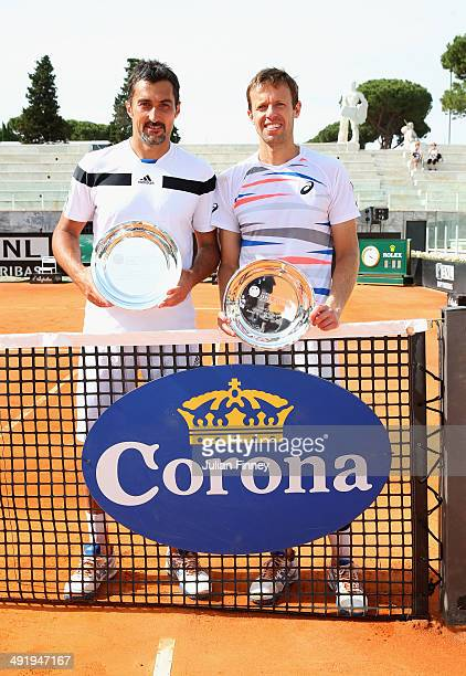 Daniel Nestor of Canada and Nenad Zimonjic of Serbia with the winners trophy after defeating Robin Haase of Holland and Feliciano Lopez of Spain in...