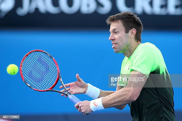 Daniel Nestor of Canada in action in their first round mixed doubles match with Kristina Mladenovic of France against Barbora Zahlavova Strycova of...