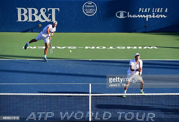 Daniel Nestor of Canada looks on as Lukasz Kubot of Poland serves to Eric Butorac and Scott Lipsky during the fifth day of the WinstonSalem Open at...