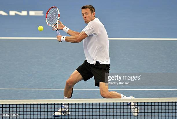 Daniel Nestor of Canada plays a forehand volley in the Mens Doubles Final partnered with Mariusz Fyrstenberg in their match against Robert Farah of...