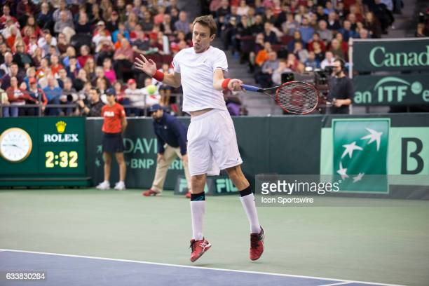 Daniel Nestor of Canada returns a serve against Dominic Inglot and Jamie Murray of Great Britain in men's doubles play on February 04 during the...