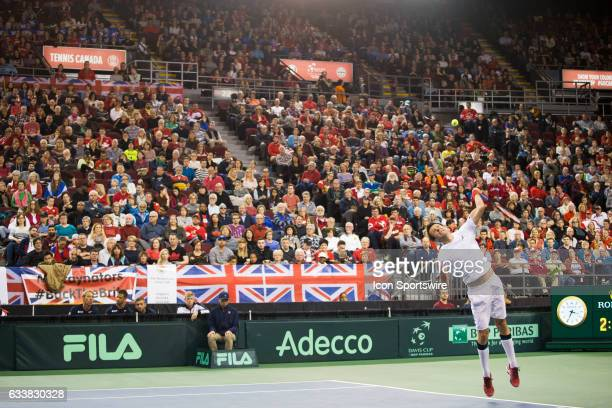 Daniel Nestor of Canada serves against Dominic Inglot and Jamie Murray of Great Britain in men's doubles play on February 04 during the Davis Cup...