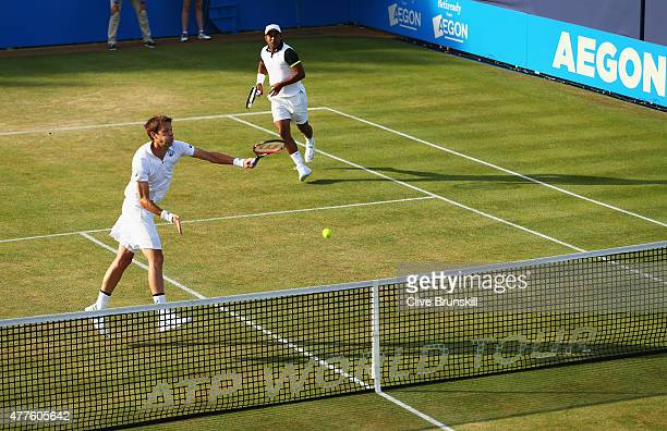 Daniel Nestor of Canada smashes partnering Leander Paes of India in their men's doubles quarterfinal match against Rafael Nadal of Spain and Marc...