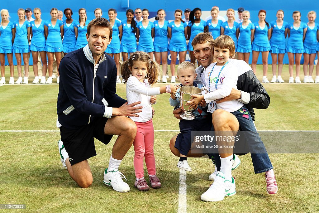 Daniel Nestor of Canada with daughter Tiana and Max Mirnyi of Belarus with son Demid and daughter Petra after winning their mens double final round match against Bob Bryan and Mike Bryan of the USA on day seven of the AEGON Championships at Queens Club on June 17, 2012 in London, England.