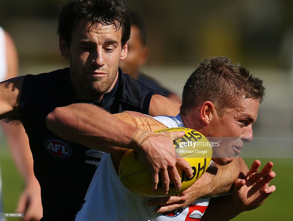Daniel Nicholson gets tackled by Cameron Pederson during a Melbourne Demons AFL training session at Gosch's Paddock on May 2, 2013 in Melbourne, Australia.