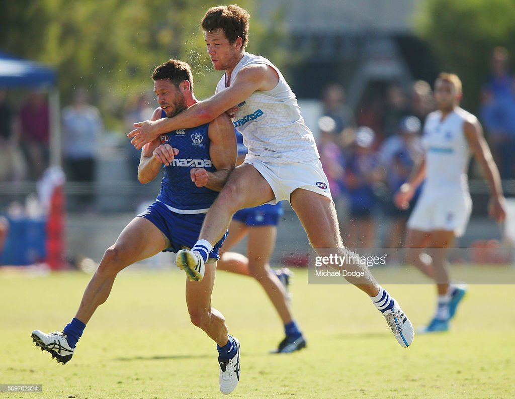 Daniel Nielson kicks the ball for a goal after clashing heads with Sam Gibson of the Kangaroos during the North Melbourne AFL Intra-Club match at Arden Street Ground on February 12, 2016 in Melbourne, Australia.
