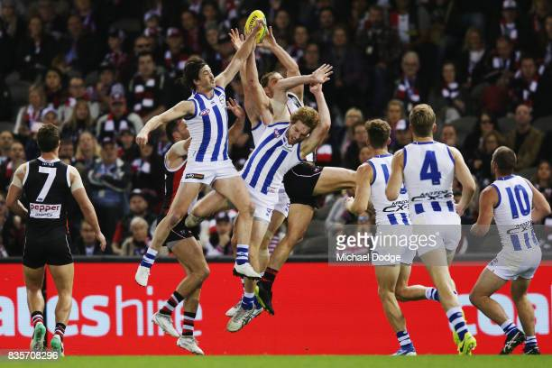 Daniel Nielson of the Kangaroos is crunched in this contest and was taken off on a stretcher during the round 22 AFL match between the St Kilda...