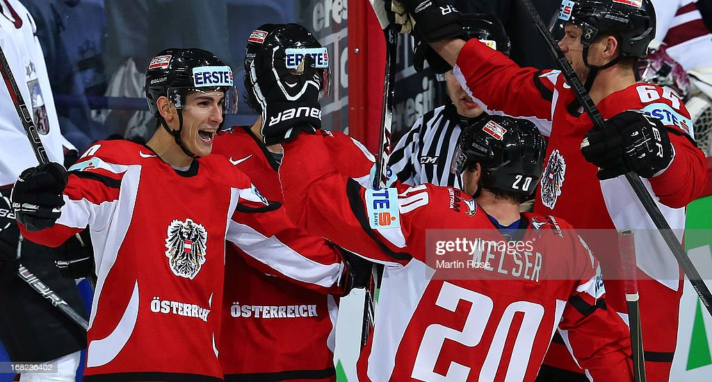 Daniel Oberkofler (L) of Austria celebrate with his team mates after he scores his team's 5th goal during the IIHF World Championship group H match between Austria and Latvia at Hartwall Areena on May 7, 2013 in Helsinki, Finland.
