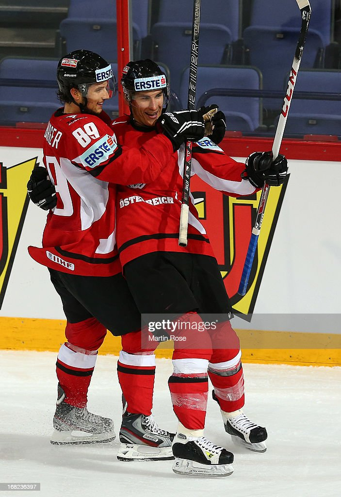 Daniel Oberkofler (R) of Austria celebratw with team mates Raphael Herburger (#89) after he Scores his team's 5th goal during the IIHF World Championship group H match between Austria and Latvia at Hartwall Areena on May 7, 2013 in Helsinki, Finland.