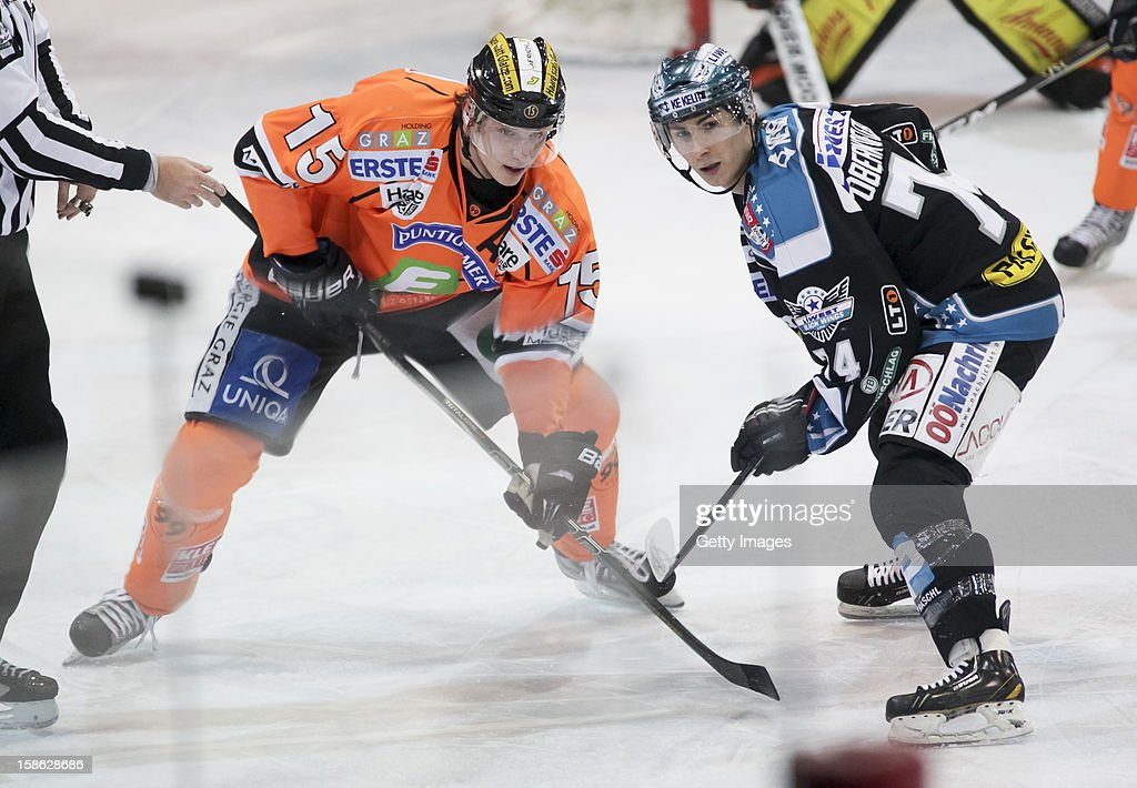 <a gi-track='captionPersonalityLinkClicked' href=/galleries/search?phrase=Daniel+Oberkofler&family=editorial&specificpeople=7543239 ng-click='$event.stopPropagation()'>Daniel Oberkofler</a> of Linz (R) challenges Matthias Iberer of Graz during the Erste Bank Eishockey Liga match between Black Wings Linz and Moser Medical Graz99ers at Keine Sorgen EisArena on December 21, 2012 in Linz, Austria.