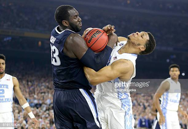 Daniel Ochefu of the Villanova Wildcats and Kennedy Meeks of the North Carolina Tar Heels fight for the ball in the second half of the 2016 NCAA...
