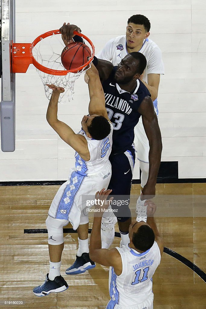 Daniel Ochefu of the Villanova Wildcats dunks the ball against Marcus Paige of the North Carolina Tar Heels in the first half during the 2016 NCAA...