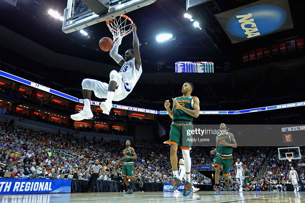 <a gi-track='captionPersonalityLinkClicked' href=/galleries/search?phrase=Daniel+Ochefu&family=editorial&specificpeople=9986325 ng-click='$event.stopPropagation()'>Daniel Ochefu</a> #23 of the Villanova Wildcats dunks the ball in the second half against the Miami Hurricanes during the 2016 NCAA Men's Basketball Tournament South Regional at KFC YUM! Center on March 24, 2016 in Louisville, Kentucky.