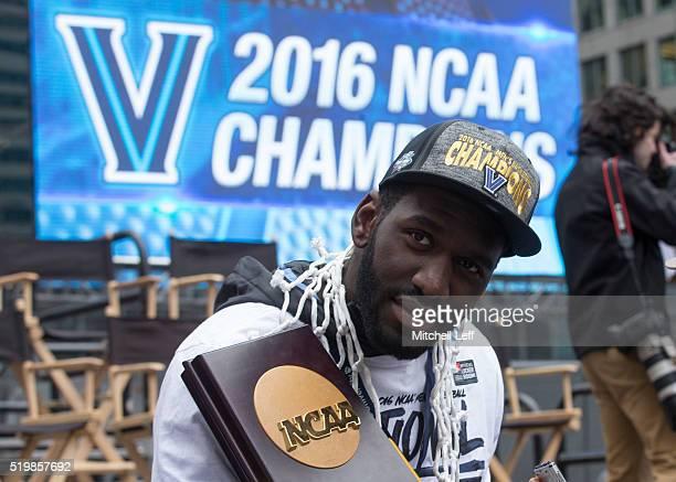 Daniel Ochefu of the Villanova Wildcats holds the NCAA National Championship trophy during the Villanova Wildcats Championship Parade on April 8 2016...