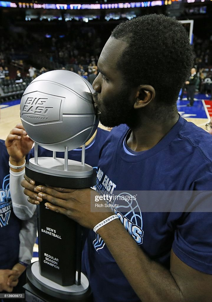 <a gi-track='captionPersonalityLinkClicked' href=/galleries/search?phrase=Daniel+Ochefu&family=editorial&specificpeople=9986325 ng-click='$event.stopPropagation()'>Daniel Ochefu</a> #23 of the Villanova Wildcats kisses the Big East regular Season Championship trophy after defeating the Georgetown Hoyas 84-71 in an NCAA college basketball game on March 5, 2016 at the Wells Fargo Center in Philadelphia, Pennsylvania.