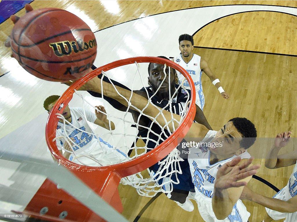Daniel Ochefu of the Villanova Wildcats shoots the ball against Marcus Paige of the North Carolina Tar Heels in the first half of the 2016 NCAA Men's...