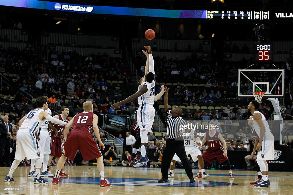 <a gi-track='captionPersonalityLinkClicked' href=/galleries/search?phrase=Daniel+Ochefu&family=editorial&specificpeople=9986325 ng-click='$event.stopPropagation()'>Daniel Ochefu</a> #23 of the Villanova Wildcats tips off against Dan Trist #20 of the Lafayette Leopards to start the first half during the second round of the 2015 NCAA Men's Basketball Tournament at Consol Energy Center on March 19, 2015 in Pittsburgh, Pennsylvania.