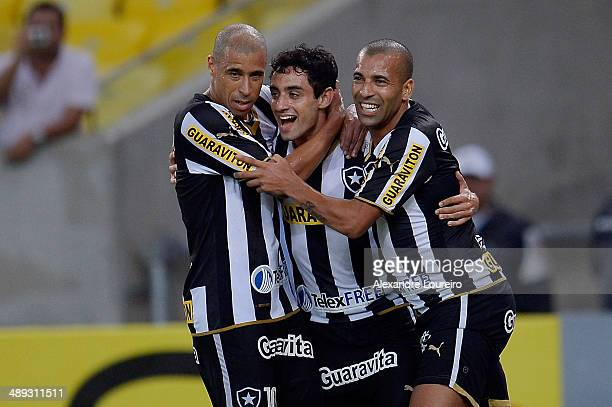 Daniel of Botafogo celebrates is second scored goal with Jorge Wagner and Emerson Sheik during the match between Botafogo and Criciumae as part of...