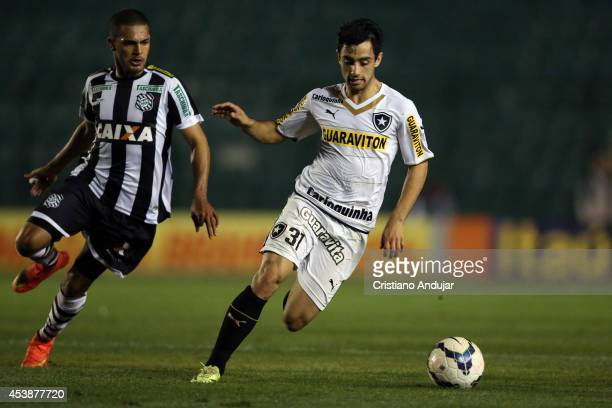 Daniel of Botafogo run to the ball with Clayton of Figueirense behind him during a match between Figueirense and Botafogo as part of Campeonato...