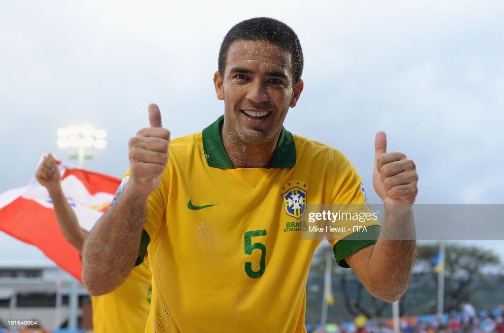 Daniel of Brazil celebrates victory in the FIFA Beach Soccer World Cup Tahiti 2013 Quarter Final match between Brazil and Japan at the Tahua To'ata Stadium on September 25, 2013 in Papeete, French Polynesia.