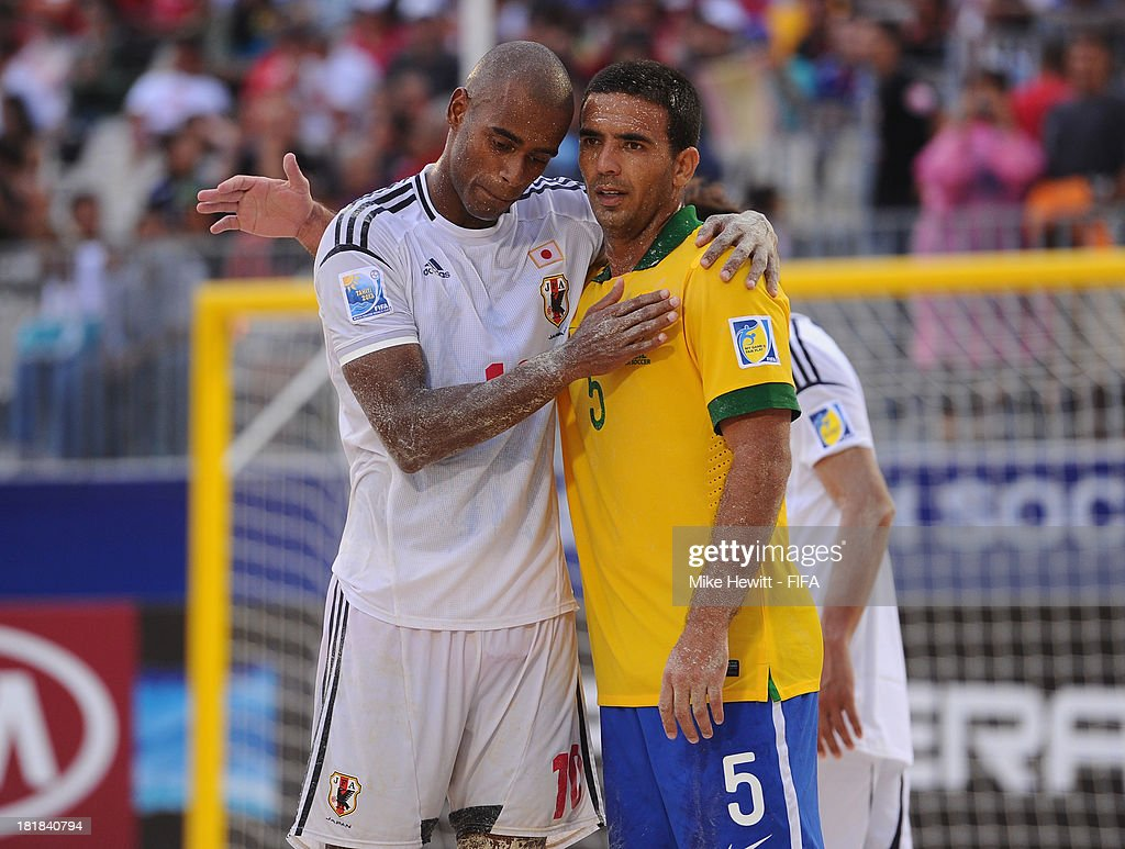 Daniel of Brazil consoles Ozu Moreira of Japan after the FIFA Beach Soccer World Cup Tahiti 2013 Quarter Final match between Brazil and Japan at the Tahua To'ata Stadium on September 25, 2013 in Papeete, French Polynesia.