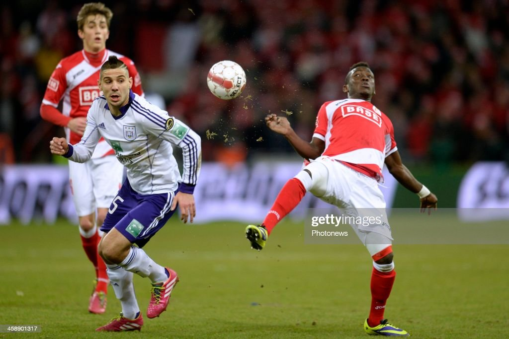 Daniel Opare of Standard battles for the ball with Aleksandar Mitrovic of RSC Anderlecht during the Jupiler League match between Standard Liege and RSC Anderlecht on December 22, 2013 in Liege, Belgium.
