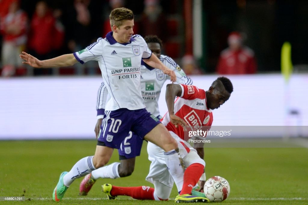 Daniel Opare of Standard battles for the ball with Dennis Praet of RSC Anderlecht during the Jupiler League match between Standard Liege and RSC Anderlecht on December 22, 2013 in Liege, Belgium.