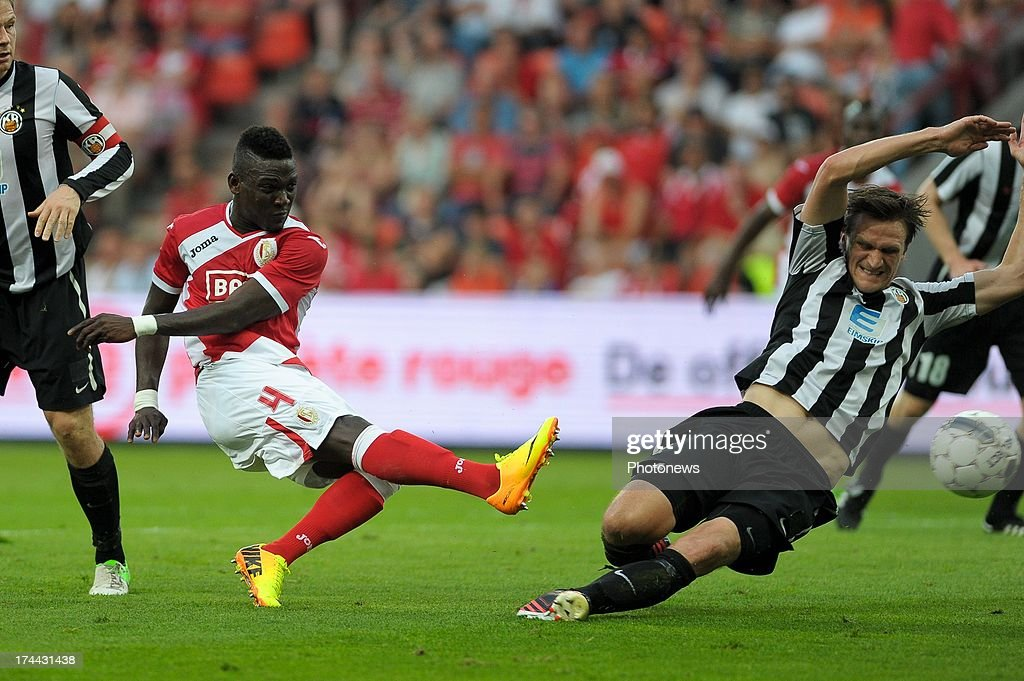 Daniel Opare #4 of Standard de Liege kicks the ball during a Europa League match against KR Reykjavik on July 25 , 2013 in Liege, Belgium.