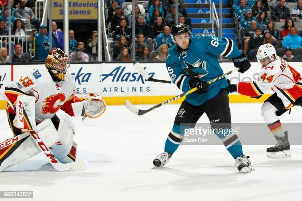 Daniel O'Regan of the San Jose Sharks tips the puck by David Rittich of the Calgary Flames for a goal in the third period at SAP Center at San Jose...