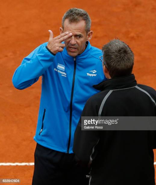 Daniel Orsanic captain of Argentina argues with the court authority during a singles match between Carlos Berlocq and Paolo Lorenzi as part of day 3...