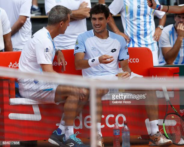 Daniel Orsanic captain of Argentina talks to Guido Pella of Argentina during a singles match between Guido Pella and Fabio Fognini as part of day 3...