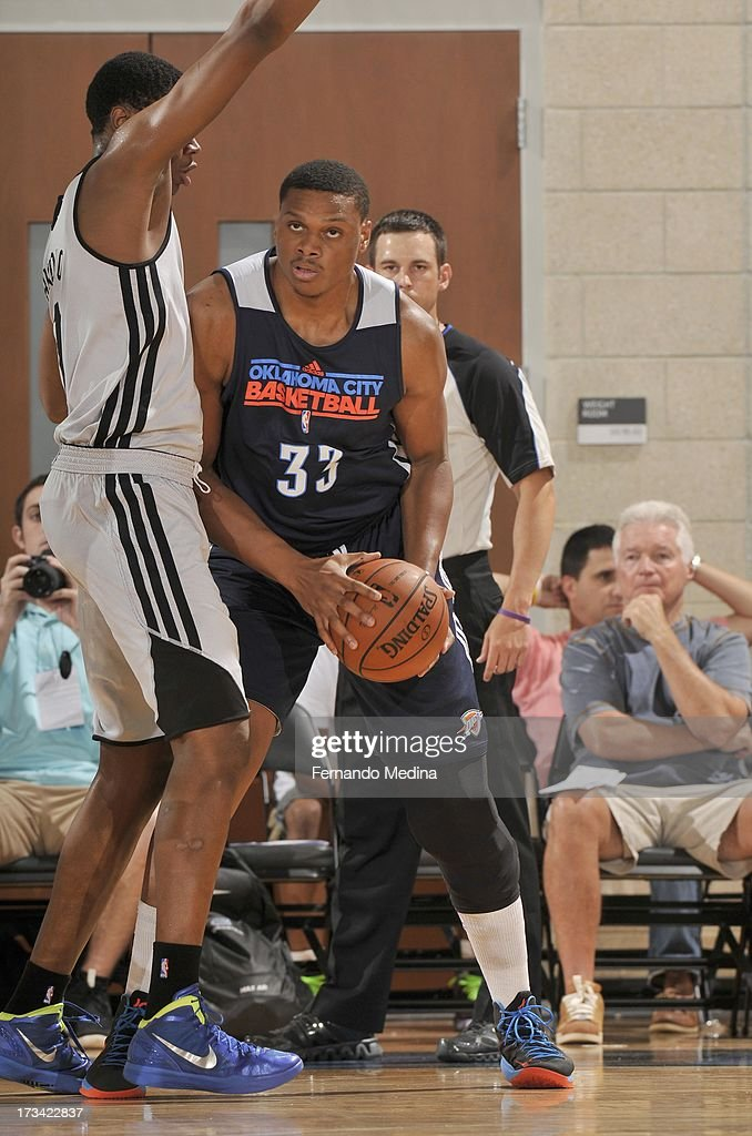 Daniel Orton #33 of the Oklahoma City Thunder drives under pressure during the 2013 Southwest Airlines Orlando Pro Summer League game between the Oklahoma City Thunder and the Houston Rockets on July 12, 2013 at Amway Center in Orlando, Florida.