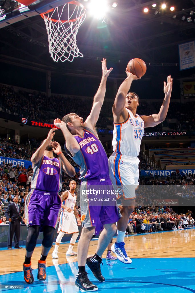 Daniel Orton #33 of the Oklahoma City Thunder shoots in the lane against Luke Zeller #40 of the Phoenix Suns on February 8, 2013 at the Chesapeake Energy Arena in Oklahoma City, Oklahoma.