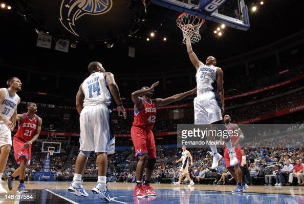 Daniel Orton of the Orlando Magic dunks the ball against the Philadelphia 76ers during the game on April 16 2012 at Amway Center in Orlando Florida...