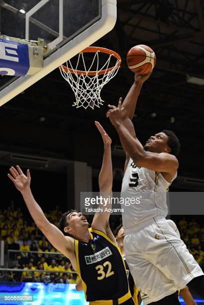 Daniel Orton of the SeaHorse Mikawa shoots over Ryan Rossiter of the Tochigi Brex during the BLeague game between Tochigi Brex and Seahorses Mikawa...