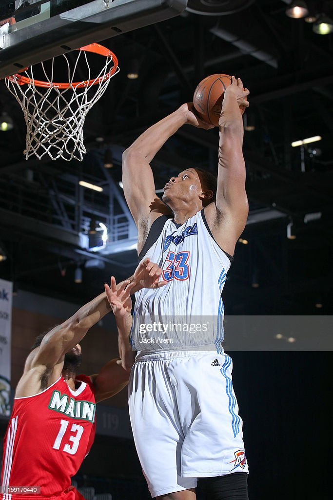 Daniel Orton #33 of the Tulsa 66ers slam dunks the ball against the Main Red Claws during the 2013 NBA D-League Showcase on January 8, 2013 at the Reno Events Center in Reno, Nevada.