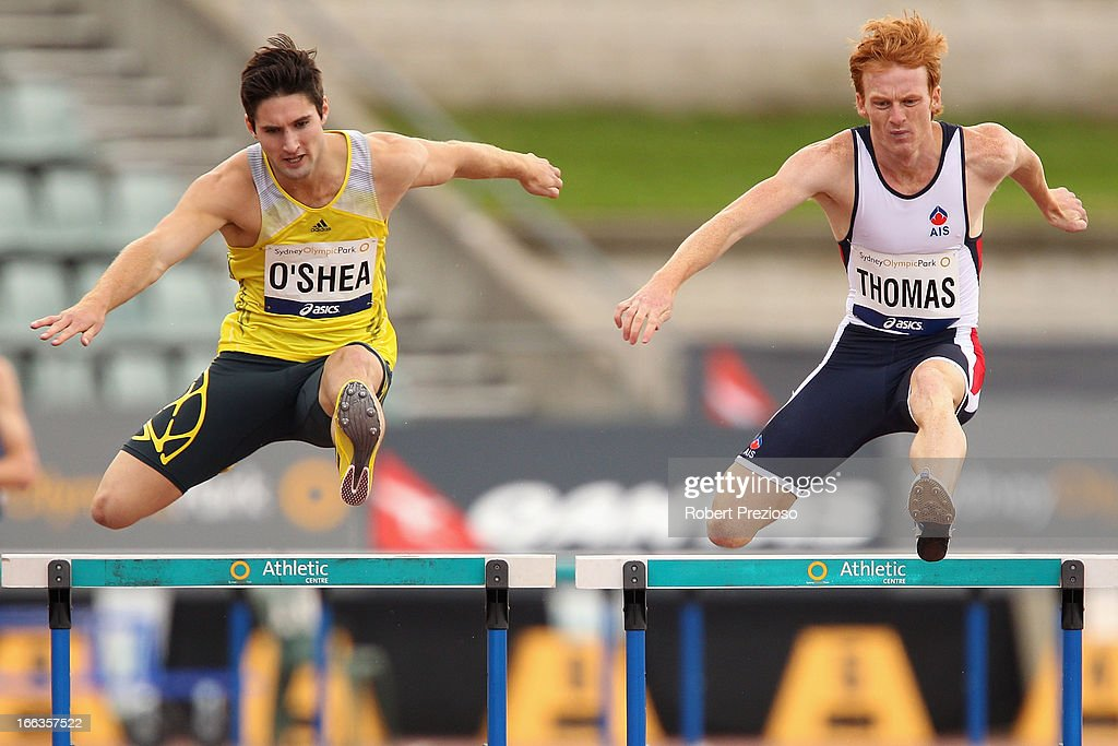 Daniel O'Shea (L) of NZL and Tristan Thomas (R) of AIS compete in Men 400m Hurdles Open Preliminary during day two of the Australian Athletics Championships at Sydney Olympic Park Athletic Centre on April 12, 2013 in Sydney, Australia.