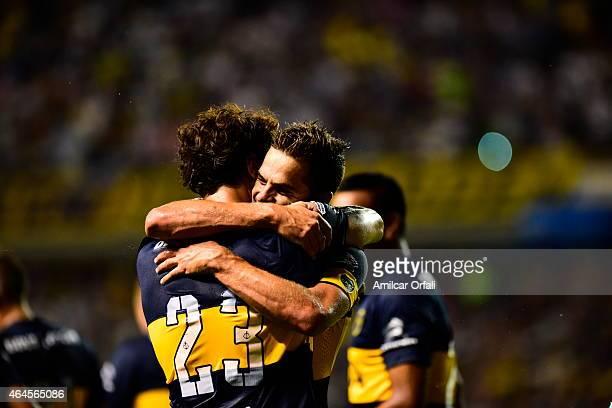 Daniel Osvaldo of Boca Juniors celebrates with Fernando Gago after scoring his team's second goal during a match between Boca Juniors and Montevideo...
