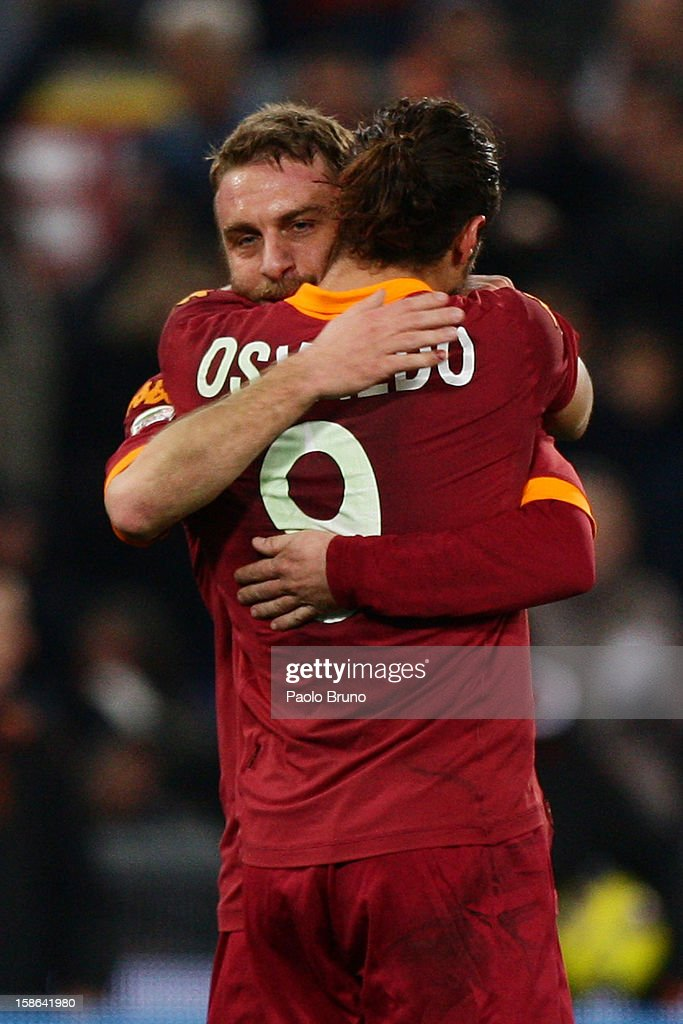 Daniel Pablo Osvaldo (R) with his teammate Daniele De Rossi of AS Roma celebrates after the third team's goal scored by Erik Lamela during the Serie A match between AS Roma and AC Milan at Stadio Olimpico on December 22, 2012 in Rome, Italy.