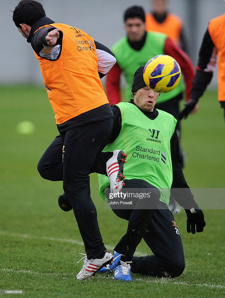 Daniel Pacheco (L) and Lucas Leiva of Liverpool in action during a training session at Melwood Training Ground on December 20, 2012 in Liverpool, England.
