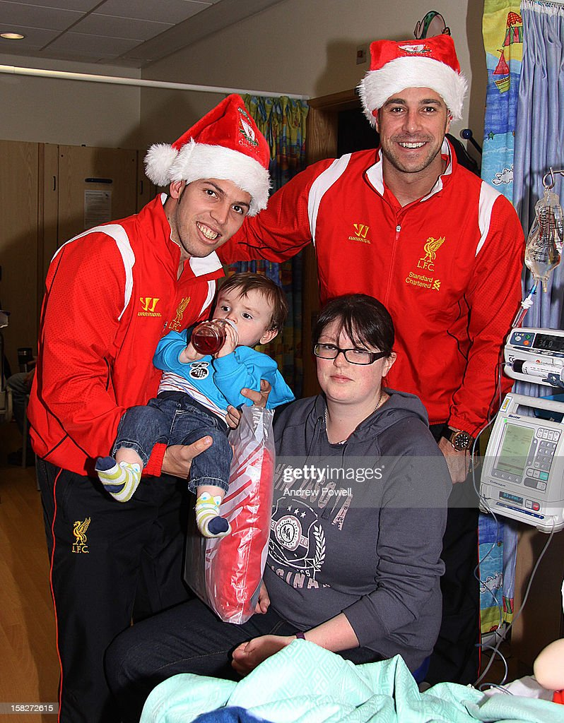 Daniel Pacheco and Pepe Reina of Liverpool FC visit Alder Hey Children's Hospital on December 12, 2012 in Liverpool, England.