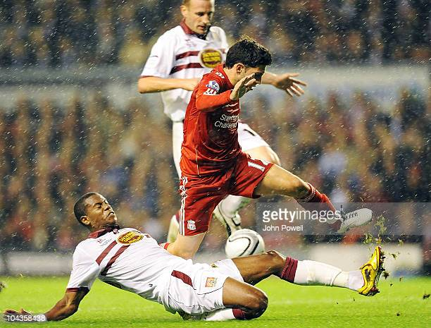 Daniel Pacheco of Liverpool leaps over a challenge of Liam Davis of Northampton Town during the Carling Cup 3rd round game between Liverpool and...