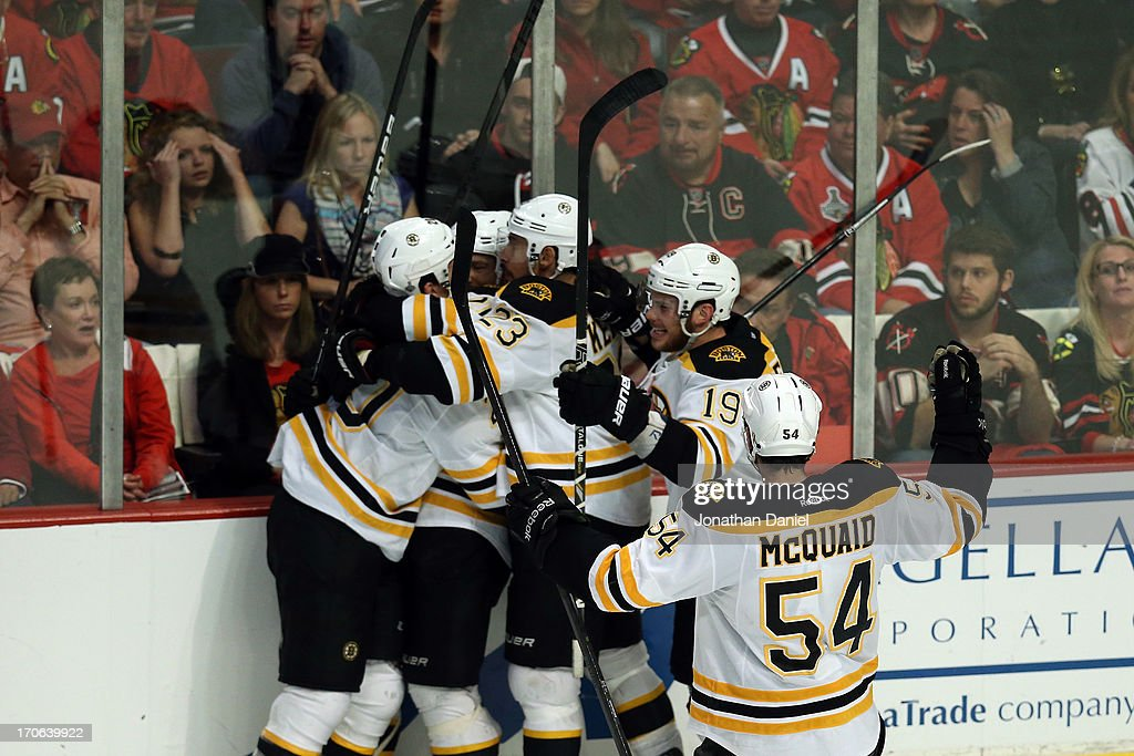 Daniel Paille (L) #20 of the Boston Bruins celebrates with his teammates after he scored the game-winning goa in overtime against the Chicago Blackhawks in Game Two of the NHL 2013 Stanley Cup Final at United Center on June 15, 2013 in Chicago, Illinois.
