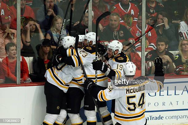 Daniel Paille of the Boston Bruins celebrates with his teammates after he scored the gamewinning goa in overtime against the Chicago Blackhawks in...